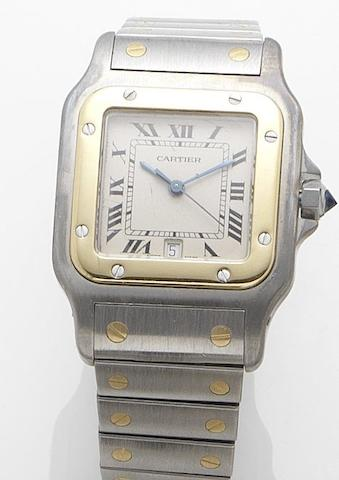 Cartier. A stainless steel and gold quartz calendar bracelet watchSantos, Recent