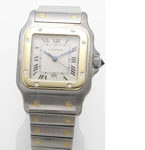 Cartier. A stainless steel and gold quartz calendar bracelet watch Santos, Recent