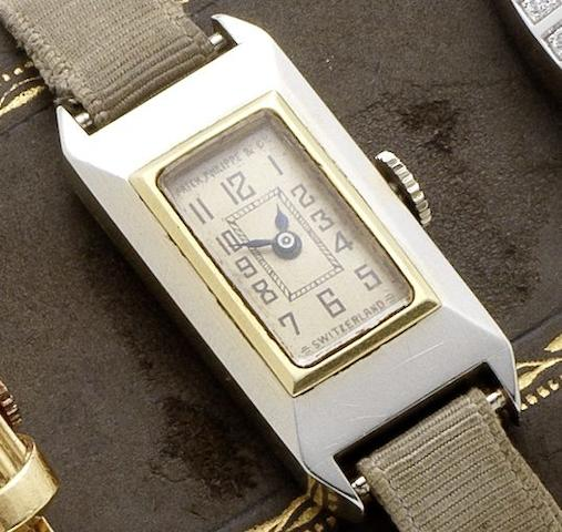 Patek Philippe. A fine two colour gold manual wind lady's wristwatch together with original numbered box, spare glass and Extract from Archives Case No.607997, Movement No.820164, Sold August 6th, Circa 1920