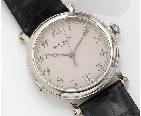 Patek Philippe. A fine 18ct white gold automatic calendar wristwatch together with fitted box and Extract from ArchivesCalatrava, Ref:5053, Case No.4230545, Movement No. 3357072, Sold March 3rd 2004