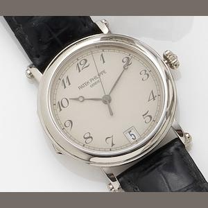 Patek Philippe. A fine 18ct white gold automatic calendar wristwatch together with fitted box and Extract from Archives Calatrava, Ref:5053, Case No.4230545, Movement No. 3357072, Sold March 3rd 2004