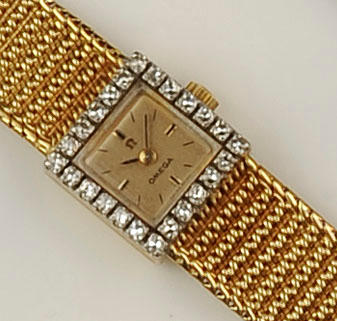 Omega: A lady's 18ct gold and diamond wristwatch