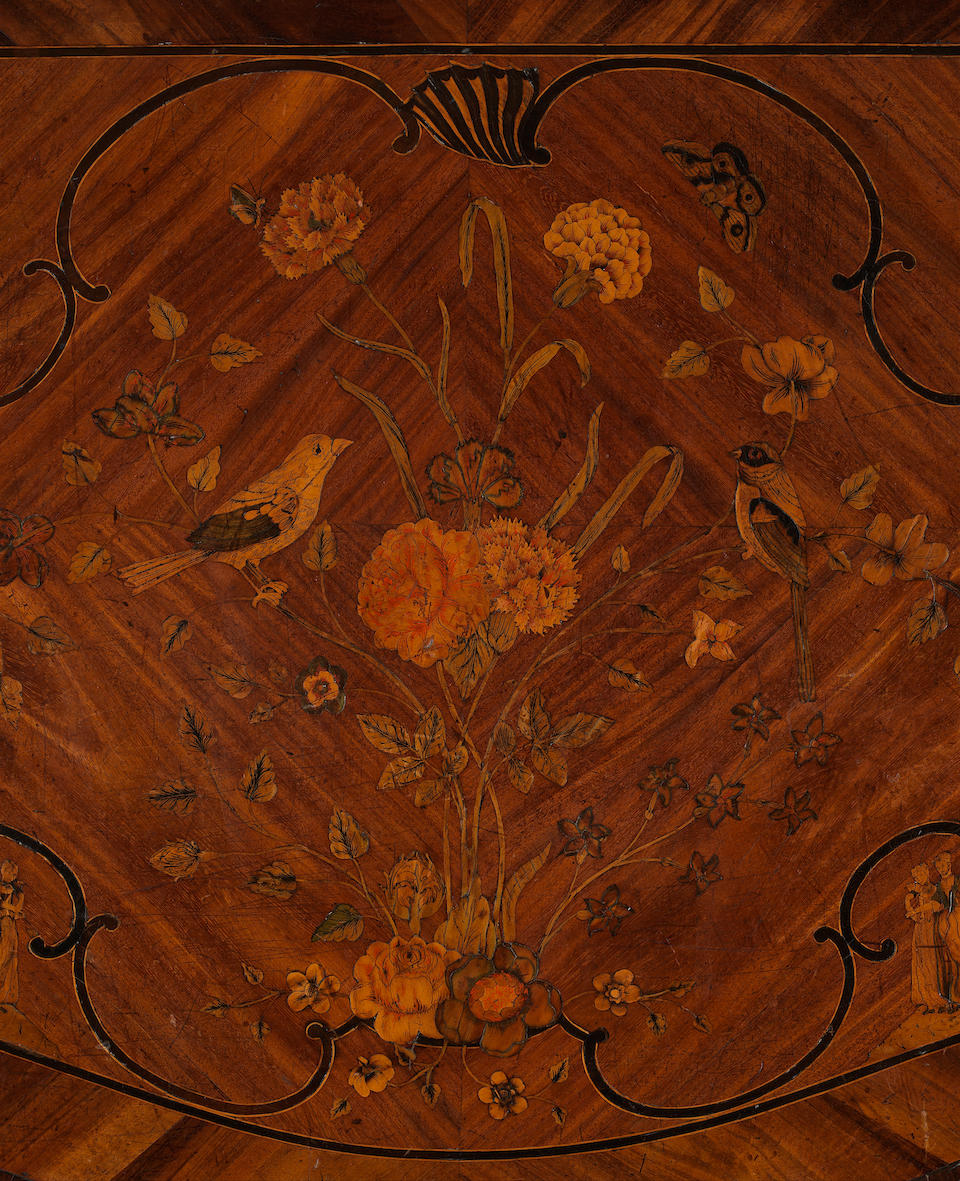 A George III padouk, sabicu and marquetry serpentine commode
