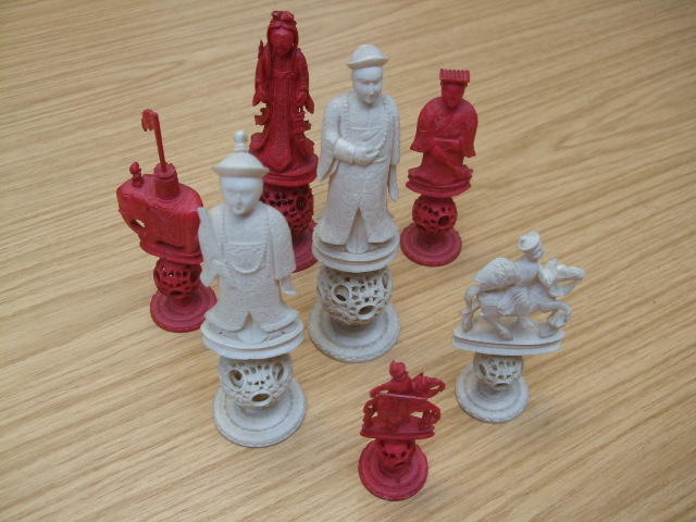 "A Chinese Export ivory ""puzzle-ball"" figural chess set"