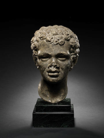 A Roman dark grey marble portrait head of an African youth