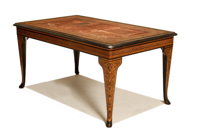 A North Italian 19th century ebonised, fruitwood and amaranth marquetry writing table