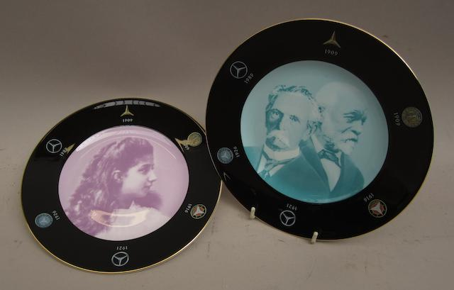 A pair of Mercedes-Benz bone china commemorative plates