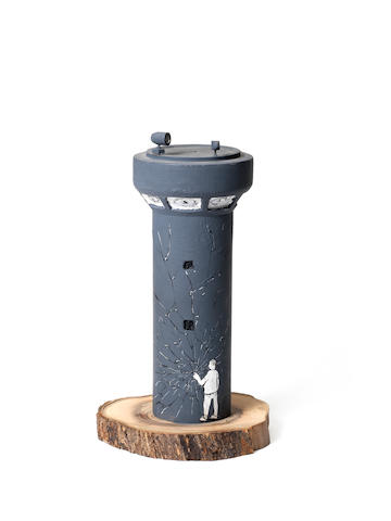 Banksy (b.1975) Watchtower Collaboration - Blu signed by both artists painted olive wood sculpture  Height: 24.5 cm.                9 5/8 in. This work was executed in 2007.
