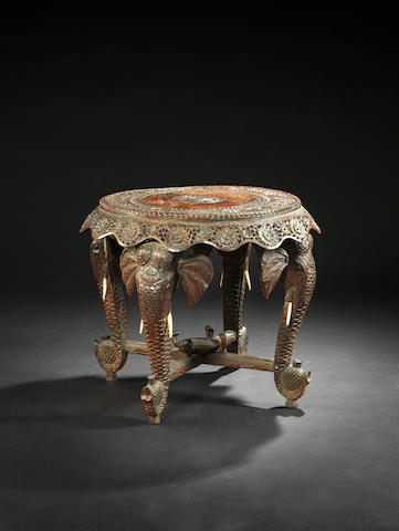 A 19th century carved Indian table, with elephant supports.