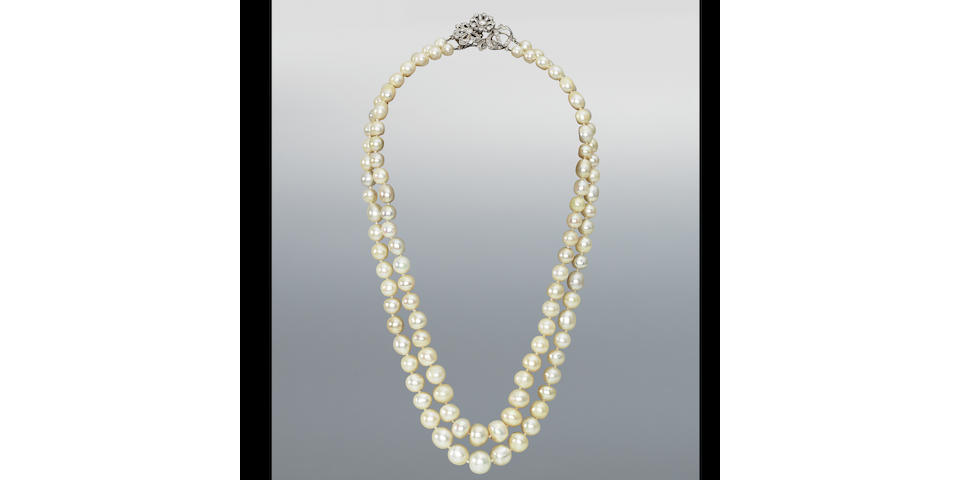 A double-row natural pearl necklace with diamond clasp