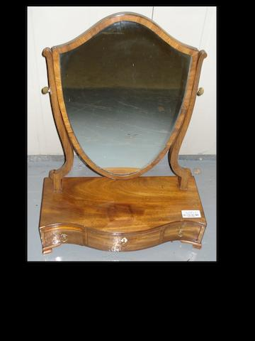 A George III mahogany shield shaped toilet mirror