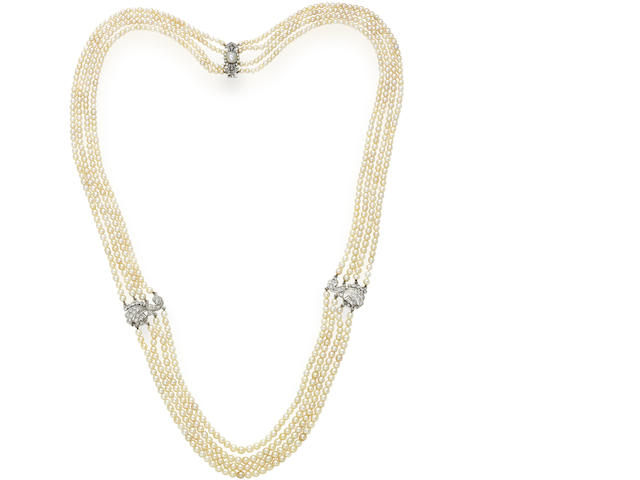 A four-row pearl and diamond necklace,