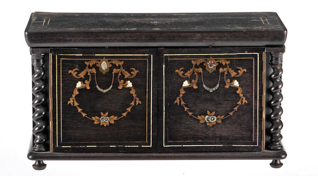A French ebonised rosewood and marquetry tea caddy c. 1840