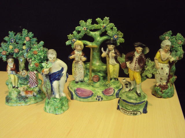 Five Staffordshire rustic figures and figure groups, 19th century