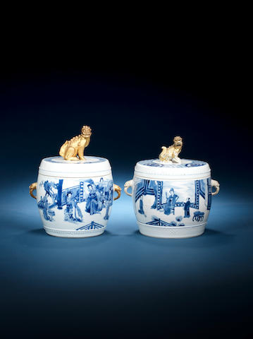 Two blue and white barrel-shaped bowls and covers Kangxi