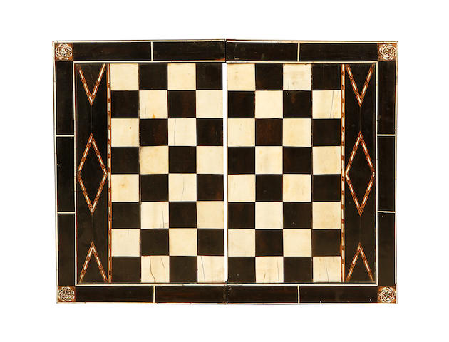 A 16th century North Italian ebony, ivory and stained bone chess board