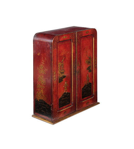 An early 20th century English red and gold lacquer wall cabinet