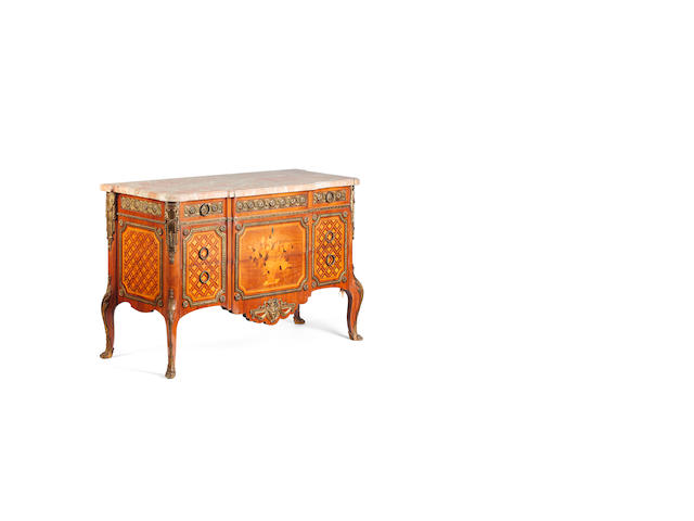 A French Transitional style walnut and gilt metal mounted commode
