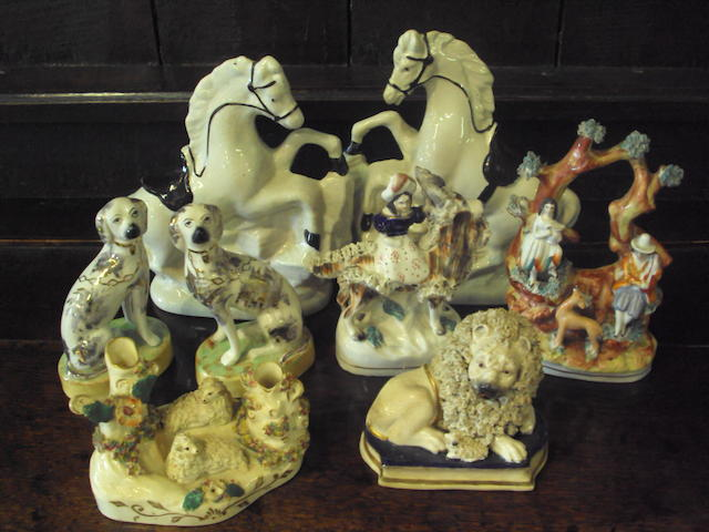 A group of eight Staffordshire animal figures