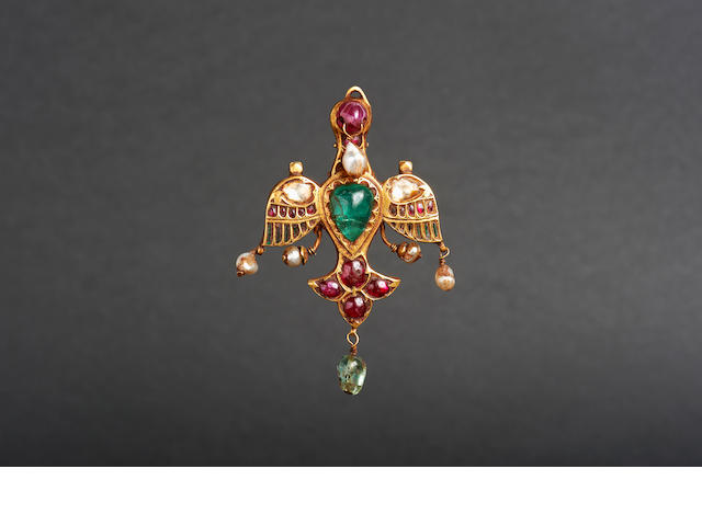 A gem-set gold pendant in the form of a bird, Mughal or Deccan, 17th century