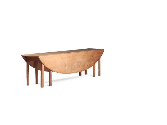 A 19th century light oak wake table