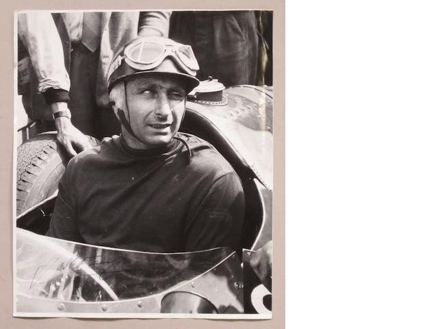 A signed photograph of Juan Manuel Fangio,