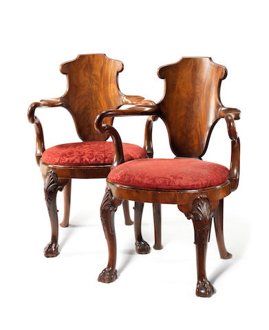 A pair of late Victorian walnut 'Shepherd's Crook' open armchairs attributed to Gillows in the George I style