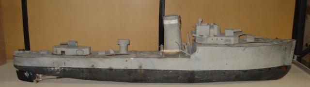 A scratch built live steam powered model of a World War II cruiser/destroyer