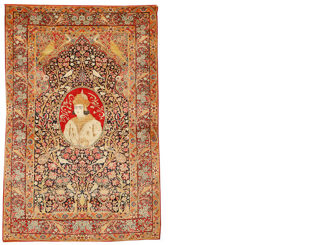 A Kirman prayer rug South East Persia, circa 1900, 6 ft 11 in x 4 ft 5 in (211 x 135 cm) some areas of restoration
