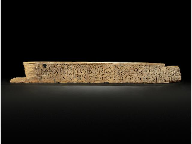 A large Nasrid calligraphic carved Wood Beam Andalusia, 14th Century