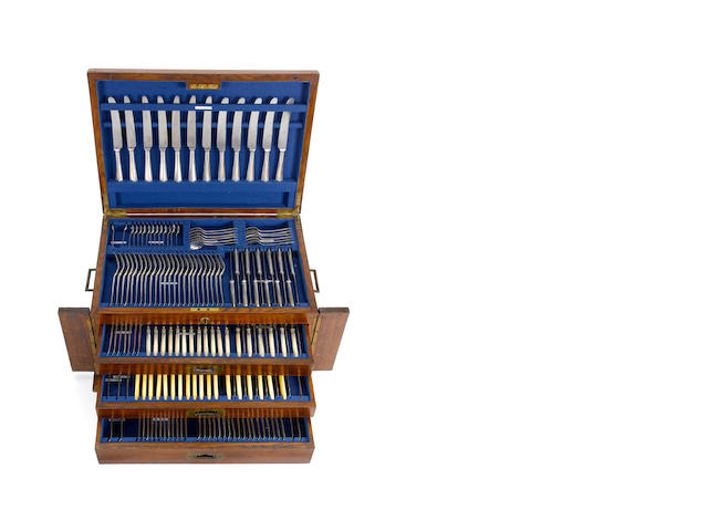 A silver Old English pattern table service of flatware and cutlery, with canteen box, predominately by Charles Boyton & Son, London 1906,