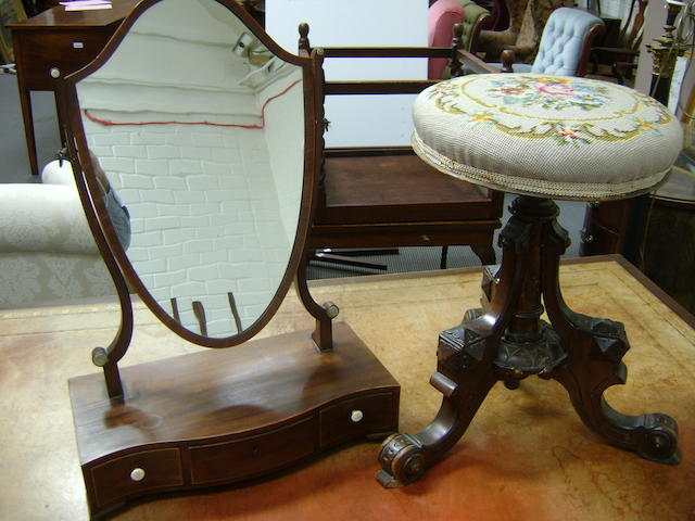 A George III mahogany toilet mirror with shield plate and serpentine box base, 43cm wide together with a Victorian walnut piano stool (2)
