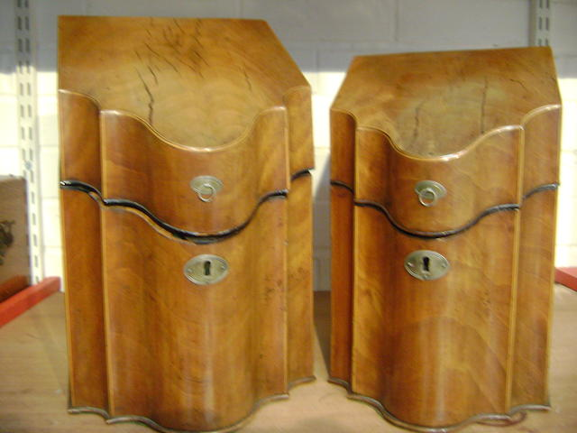 A pair of George III mahogany sized knife boxes with serpentine fronts, 36cm and 31cm high (lacking original fittings) (2)
