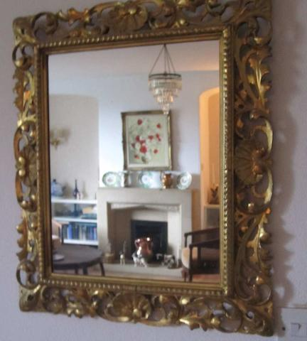 A late 19th century Italian gilt wood wall mirror