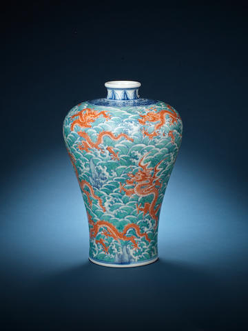 A green-glazed blue and white meiping vase (neck restored), Qianlong mark and of the period