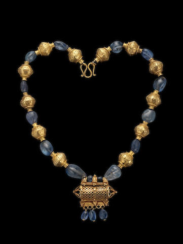 A group of gold and sapphire beads restrung as a Necklace Persia and India, 9-10th Century