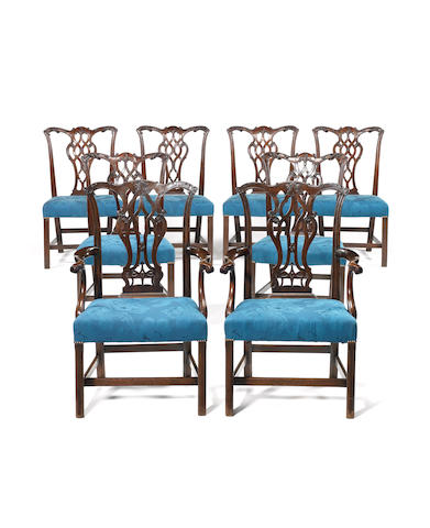 A set of six George III carved mahogany dining chairs, together with a similar pair of open armchairs in the Chippendale taste