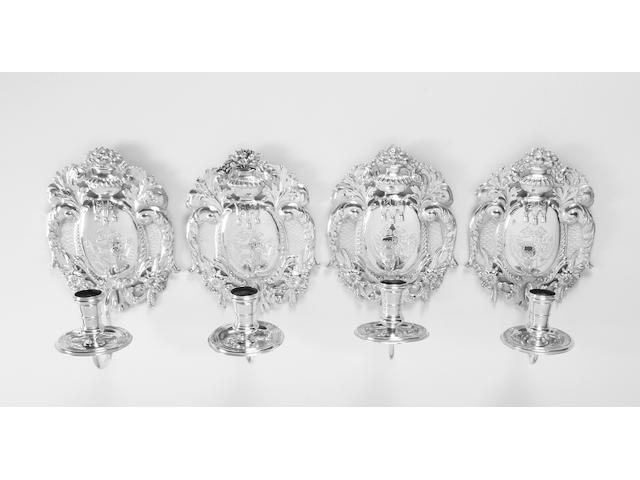 A set of four Britannia standard silver wall sconces By Crichton Brothers, London, 1922,  (4)