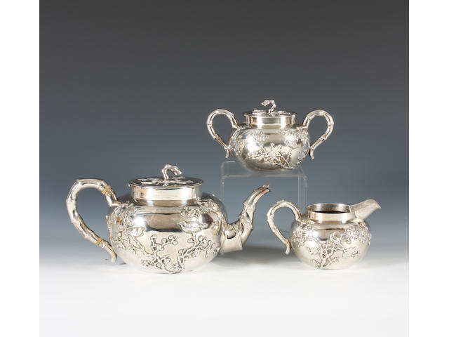 A late 19th/early 20th century Chinese Export silver three piece tea set By Wang Hing, stamped 'WH 90' and with character mark,  (3)
