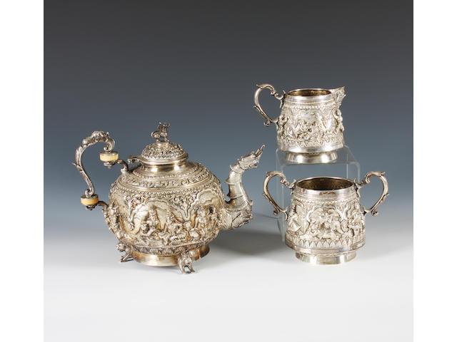 A Burmese metalware three piece tea set With retailer's stamp, 'MG.SHWE YON.BROS, Gold & Silversmith, Rangoon',  (3)