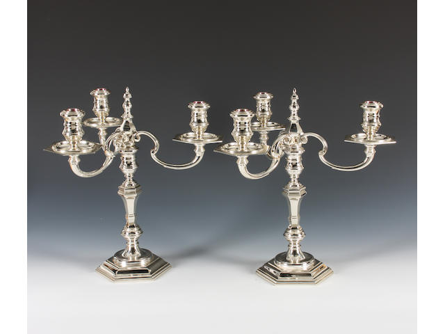 A pair of silver three branch candelabra By Garrard & Co. Ltd, London, 1965,  (2)