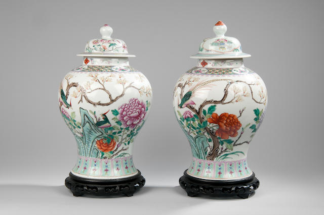A pair of Chinese famille rose vases and covers late 19th Century