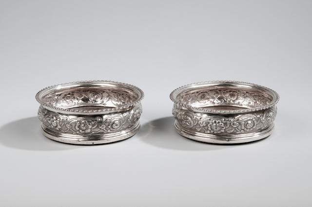 A pair of George III silver bottle coasters probably by Crispin Fuller London 1819