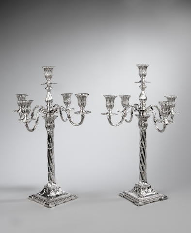 A pair of Edwardian silver five light candelabra By Henry Wilkinson Sheffield 1904