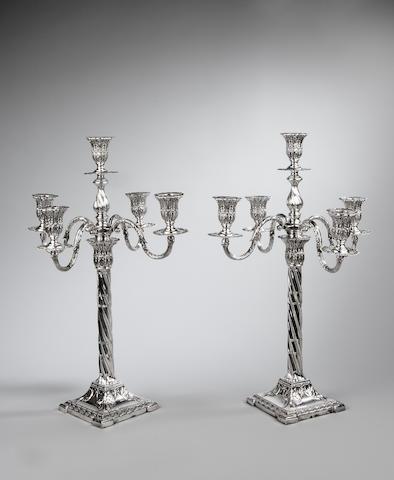 A pair of Edwardian silver five light candelabra by Henry Wilkinson Sheffield 1904