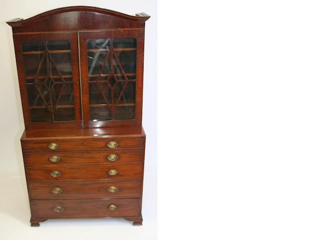 A George III mahogany secretaire chest of drawers with associated mahogany bookcase top
