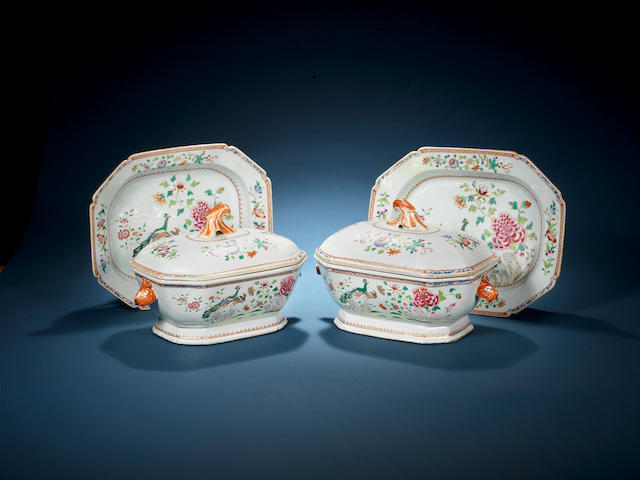 A fine and rare pair of famille rose 'double-peacock' oblong octagonal tureens, covers and stands Qianlong