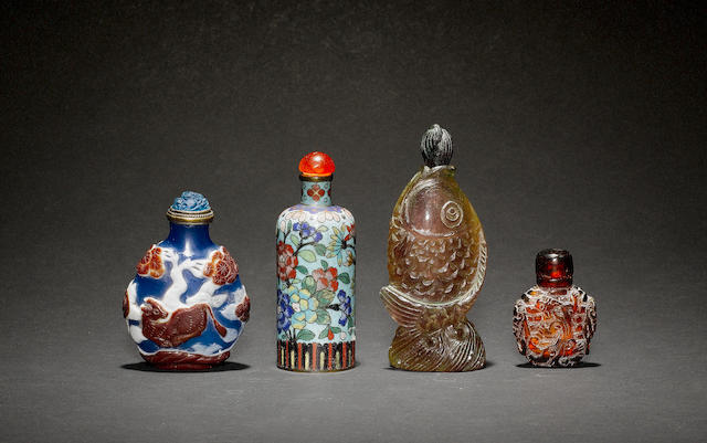 A group of four Chinese snuff bottles, including: