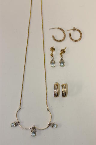 An 18ct gold aquamarine and diamond necklace and earrings ensuite