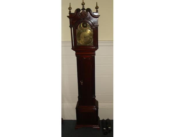 """A good 'Chippendale Revival' mahogany cased grandmother clock, the hood with moulded and rosette carved broken swan neck pediment, brass orb and spire finials, freestanding cylindrical tapering pilasters, moulded trunk door between fluted quarter pilasters, on ogee feet, the 7"""" brass dial signed 'J Walker London, with Roman and Arabic numerals, the twin train movement striking on a bell, with keys, 156cm."""